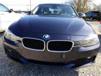 This 2013 BMW 3 Series 4dr 320i features a 2.0L 4