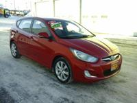 This outstanding example of a 2013 Hyundai Accent SE is