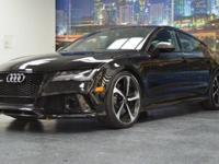 This is a Audi, RS 7 for sale by Empire Exotic Motors.