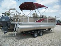 This is a NEW 2014 Bennington 24 SLX3 tri-toon. The