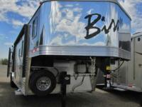This aluminum trailer with living quarters is also