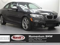 This 2014 M235i Coupe has Premium Package, Sport