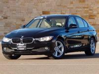 This 2014 BMW 3 Series 320i xDrive has AWD. 35/23