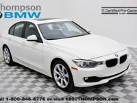 Take command of the road in the 2014 BMW 320i xDrive! A