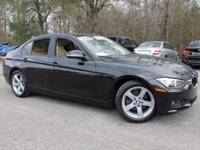 This 2014 BMW 3 Series 328i in Black Sapphire