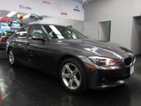 Racy yet refined, this 2014 BMW 3 Series practically