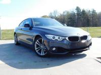 428i trim, Mineral Gray Metallic exterior and Black/Red