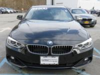 2014 BMW 428i Automatic   This Coupe has less than 36k