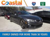 This 2014 BMW 4 Series 435i in Black features: RWD