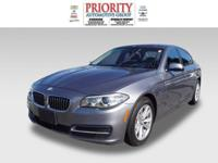 This 2014 BMW 5 Series 528i boasts features like a push
