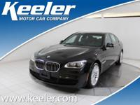 Step into the 2014 BMW 750i xDrive! Very clean and very