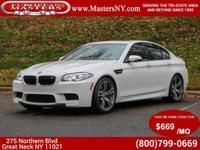 This Incredible White 2014 BMW M5 Sedan Comes Equipped