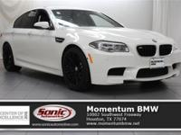 This 2014 BMW M5 Sedan comes complete with features