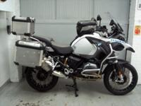 2014 BMW R1200GSA White with only 1627 miles. This bike