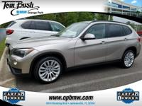 This outstanding example of a 2014 BMW X1 xDrive28i is