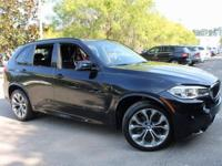 This 2014 BMW X5 xDrive35d is finished in Carbon Black