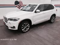 Treat yourself to a test drive in the 2014 BMW X5