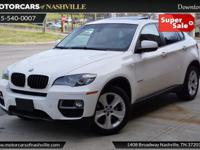 This 2014 BMW X6 4dr xDrive35i features a 3.0L I6 DOHC