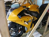 This bike is BRAND NEW!! Repossessed from the Dealer,