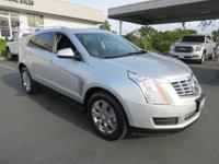 ENJOY CADILLAC LUXURY IN THIS SUV WITH A CLEAN VEHICLE