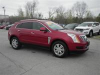 Looking for a clean, well-cared for 2014 Cadillac SRX?
