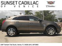 Drive home in this Low Mileage SRX. Features include: