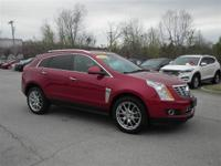 This outstanding example of a 2014 Cadillac SRX