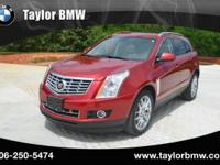 This outstanding example of a 2014 Cadillac SRX Premium