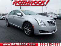 Our amazing 2014 Cadillac XTS Sedan looks radiant in