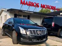 Drive away with this beautiful 2014 Cadillac XTS. Down