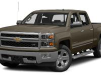 This 2014 Chevrolet Silverado 1500 LT features a hill