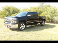 This BLACK 2014 Chevrolet Silverado 1500 LTZ might be
