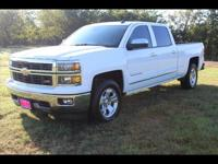This WHITE 2014 Chevrolet Silverado 1500 LTZ might be
