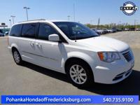 This 2014 Town and Country has a clean CARFAX and has