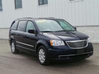 This outstanding example of a 2014 Chrysler Town &