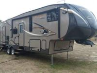 This like new 2014 Coachmen Chaparral Mid Profile