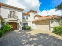 Beautiful custom lakefront home with tile roof in