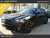This exceptional example of a 2014 Dodge Charger RT is
