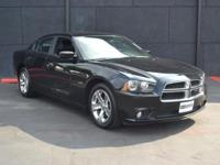 This 2014 Dodge Charger R/T features a 5.7L 8 CYLINDER