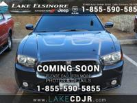This outstanding example of a 2014 Dodge Charger SXT is