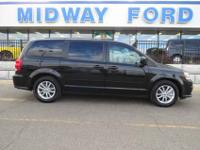 Only 21k on this gorgous black crystal mini-van! Comes