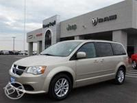 This 2014 Grand Caravan is priced in reference to NADA