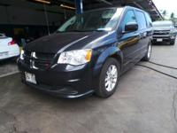 Come see this 2014 Dodge Grand Caravan . Its Automatic