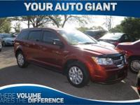 Sturdy and dependable, this Used 2014 Dodge Journey SE