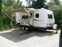 Total features include: Awning, Spare Tire Carrier &