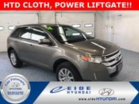 This AWD Ford Edge SEL is Mineral Gray w/ Charcoal