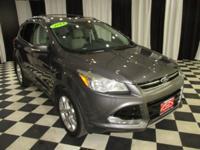 OVERVIEW This 2014 Ford Escape 4dr 4WD 4dr Titanium