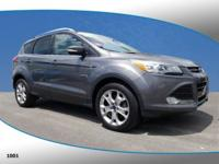 This 2014 Ford Escape Titanium in Gray features: AWD
