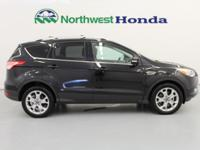 CARFAX One-Owner. Tuxedo Black Titanium AWD. AWD