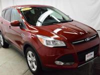 This outstanding example of a 2014 Ford Escape SE is